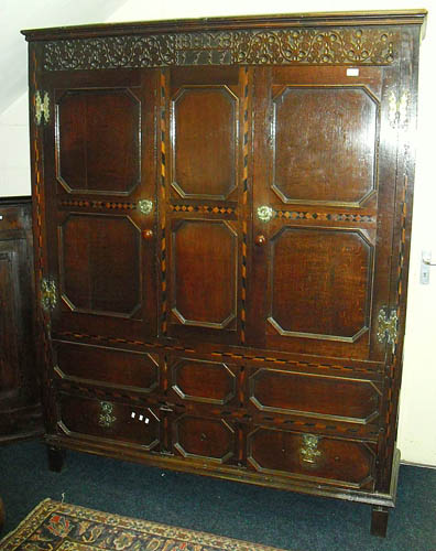 Image of Lot  954  - A large panelled oak cupboard, with inlay, with later back, top, feet, cornice etc.
