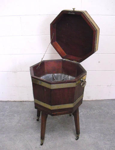 Image of Lot  643  - A Regency mahogany and boxwood strung octagonal cellarette on stand, with flat top, brass bound and with carrying handles (a/f).