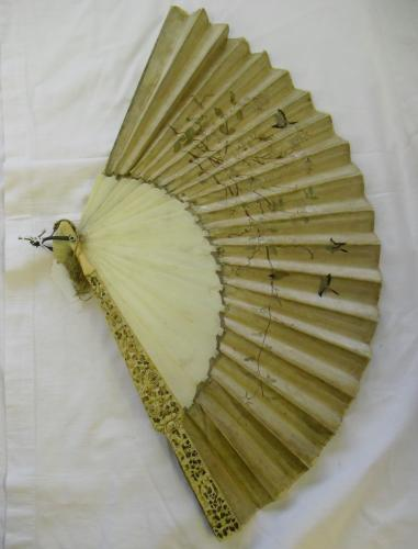 Image of Lot  574  - A Chinese carved ivory and embroidered silk fan.