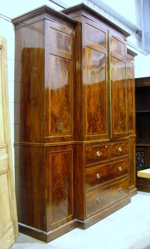 Image of Lot  684  - An Edwardian mahogany and boxwood strung breakfront four door wardrobe with central press section.