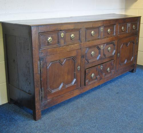Image of Lot  600  - A geometric fronted oak dresser base