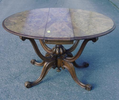 Image of Lot  867  - A Victorian burr walnut and inlaid drop leaf table on hinged base