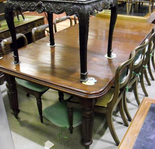 Image of Lot  535  - A Victorian mahogany wind out extending dining table with two leaves on reeded legs, no handle, castors a/f