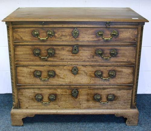 Image of Lot  699  - A Geo III mahogany chest of drawers with brushing slide, blind fretwork and canted corners on bracket feet, top a/f, split sides