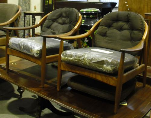 Image of Lot  557  - A 1960's teak, Greaves & Thomas, ''Villager Davenport'' three piece suite frame only comp sofa bed and pair of tub chairs (a/f)