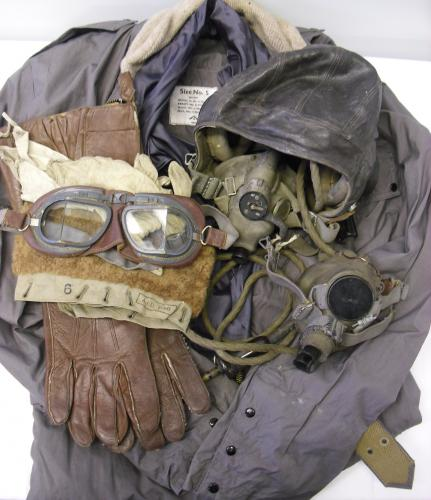 Image of Lot  100  - An RAF Lancaster navigator's flying uniform collection c1945 comprising ''C'' type leather flying helmet, Mk VIII goggles, a type ''G'' oxygen mask, a type ''H'' oxygen mask, a helmet wiring loom, a pair of gauntlets, a pair of glove liners, a Sidcot suit fur collar, a set of 22c/1051 ''Beadon Suit'' flying overalls.