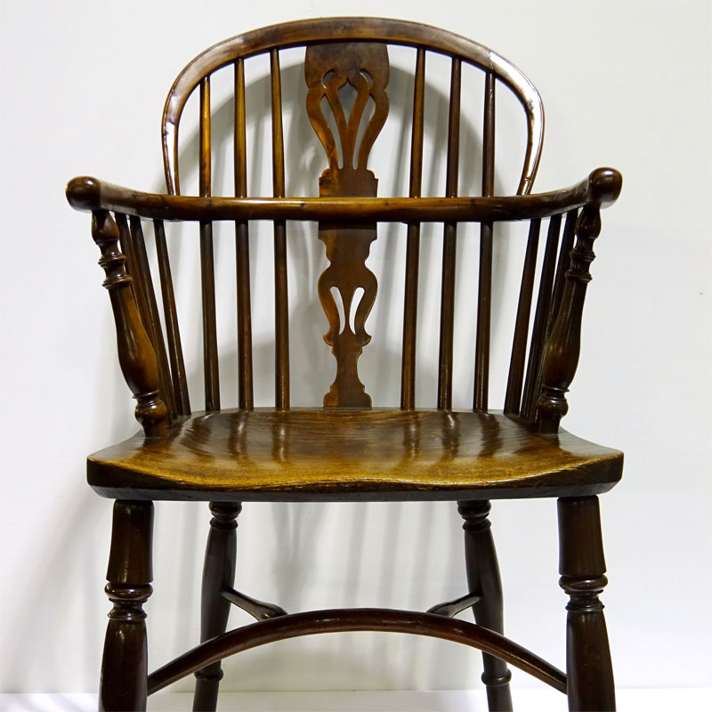 Image of Lot 507 - A 19th century low backed yew Windsor Armchair having crinoline stretcher