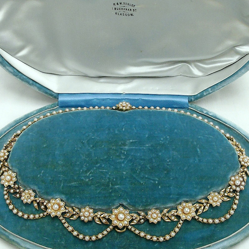 Image of Lot 492 - A Victorian floral swag necklace, yellow metal set with seed pearls presented in fitted case