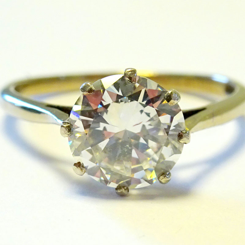"Image of Lot 127 - A solitaire ring, white metal marked ""PLAT"" set with a brilliant cut white stone"
