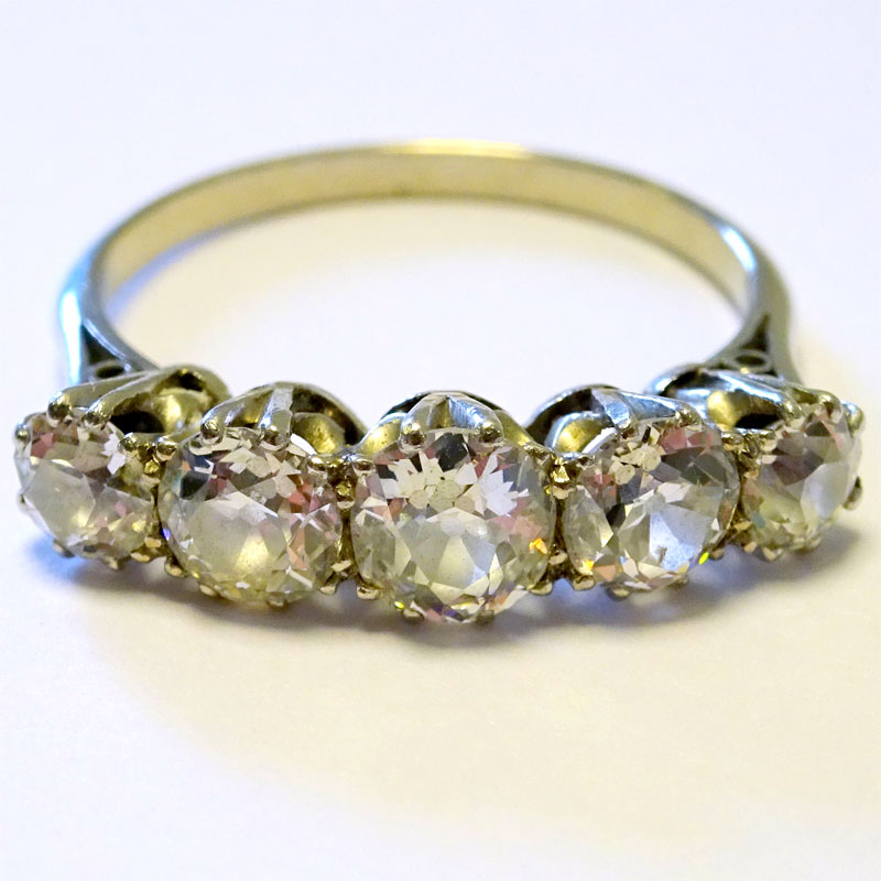 Image of Lot 128 - An eternity ring, unmarked white metal set with 5 brilliant cut white stones