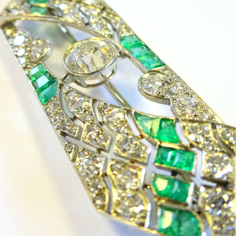 Image of Lot 137A - A panel brooch, unmarked white metal, design incorporating a principal brilliant cut white stone, 72 other various white stones & 22 calibre cut green stones, one lacking.