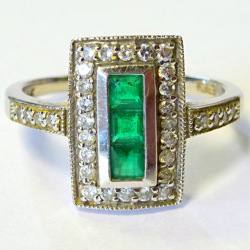 "Image of Lot 178 - A ring, white metal marked ""Platinum"" having Art Deco influence head set with 3 calibre cut green stones and 32 brilliant cut white stones"