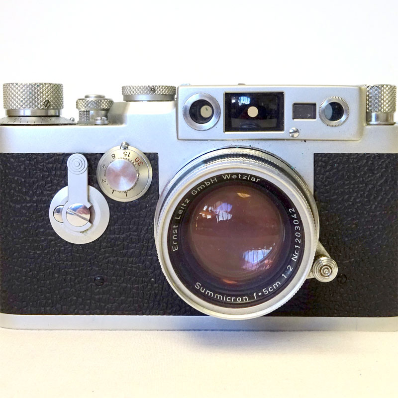 Image of Lot 179 - A Leica IIIg rangefinder camera with leather case & Leitz lens